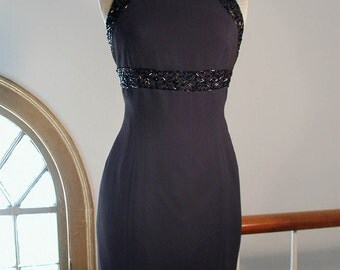 Classic Fitted Sleeveless Black Beaded Dress with Nipped Shoulders