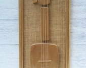 Vintage mid century modern Enesco guitar wall art, 1960s, Acacia wood, gold painted, made in Phillipines, home decor on Etsy - Treaury Featured