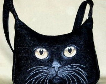 Handbag in Black Cat face  in a Denim Fabric  with smart phone pocket with a shoulder strap. This is a Large size bag.