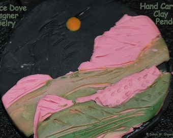 Black, Pink, Green, Orange Handcarved Clay Pendant, 1 1/2 in. dia., handmade by Designer Susan W. Showalter, 18 in-20 in.