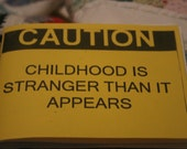 Caution, Childhod Is Stranger Than It Appears