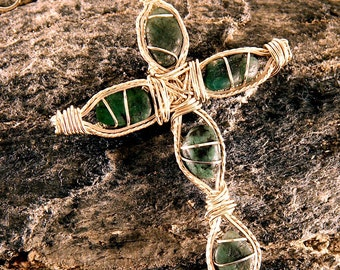 Silver Cross with 80 carats of raw Emeralds