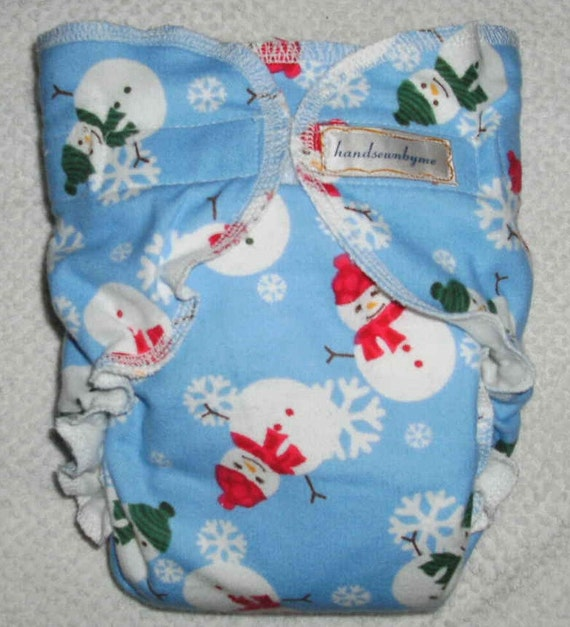 handsewnbyme 1 Fitted Cloth Diaper Approx 10-20 POUNDS Holly Jolly Snowman And Snowflakes On Ice Blue Background