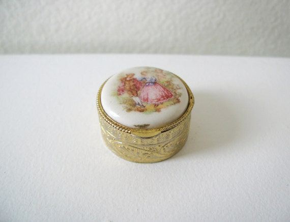 Vintage little jewelry box with painting on the top.