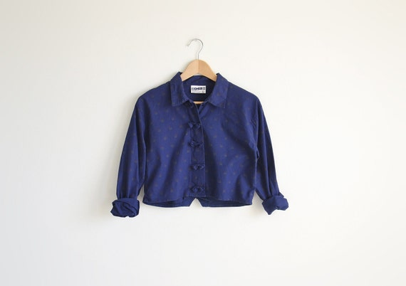 Vintage navy blue cropped shirts with ribbons.