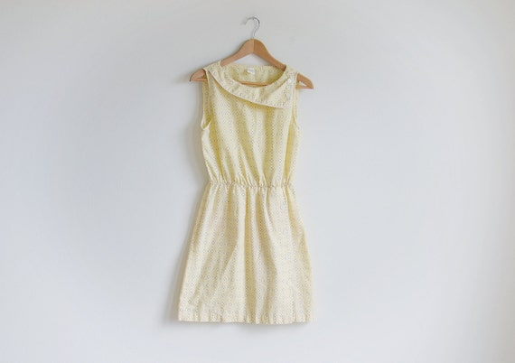 Vintage light yellow sleeveless dress with asymmetrical collar. (RESERVED FOR Jaime Calder)
