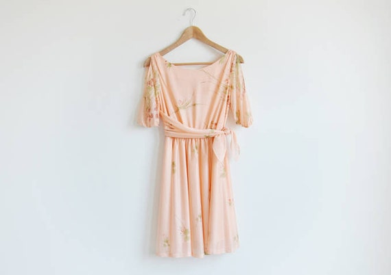 Vintage light orange floral dress with cut outs at the shoulder.