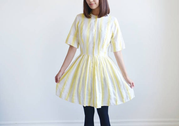 Vintage 1960s yellow and white stripe short sleeve dress.