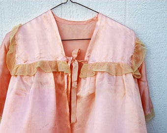 Peach Blouse with Ruffles and Ribbons