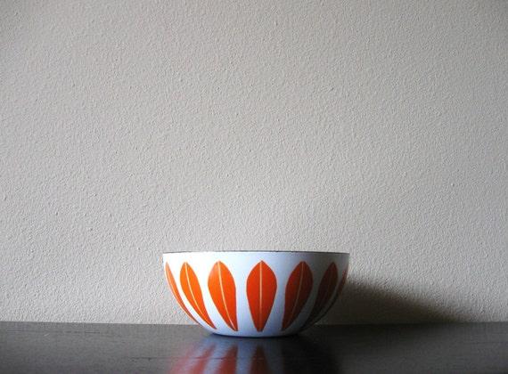 orange and white cathrineholm enamel bowl