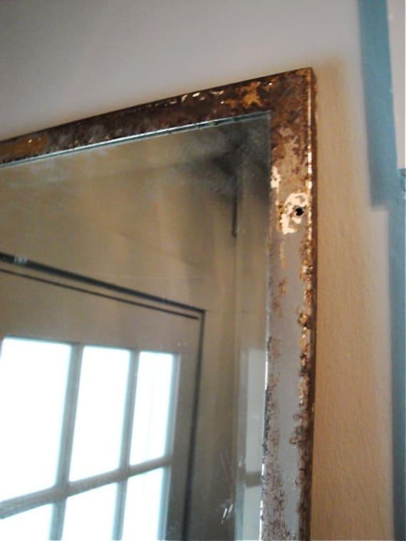Vintage industrial metal framed beveled mirror