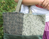green bag made from recycled upholstery fabric
