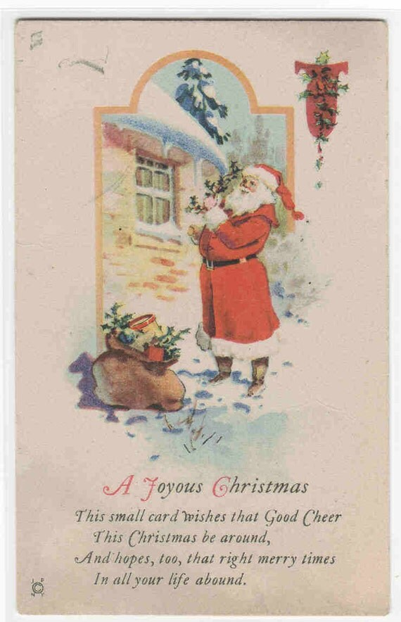 Santa Claus Hanging Holly Christmas 1910c postcard