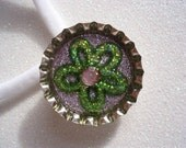Green Flower and Rhinestone Glitter Bottle Cap Magnet and a White Nylon Choker Necklace