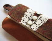 Vintage styled paisley fabric clutch pouch in brown and deep red