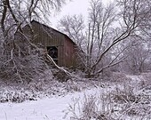 Abandoned barn in snowstorm, custom framed