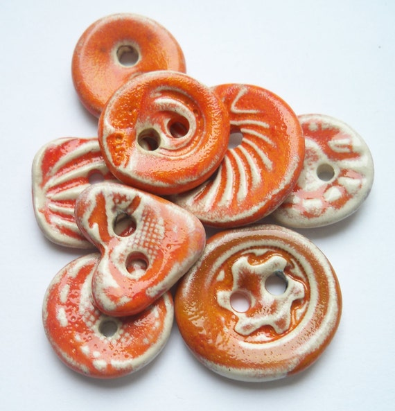 A Collection of Tangerine Orange Ceramic Buttons