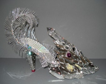"high heel shoe sculpture ""Vanity Fish"""
