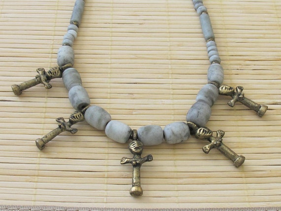 Old african clay beaded brass fertility  necklace.