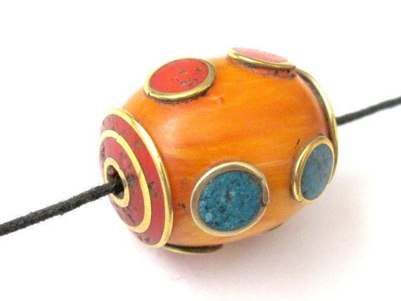 Large Tibetan copal Resin pendant bead with brass , turquoise and coral inlay - BD110
