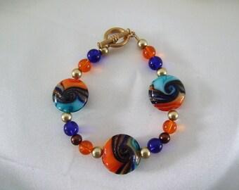 Orange, Blue and Gold Swirl