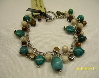 Turquoise, brown and cream bead charm bracelet