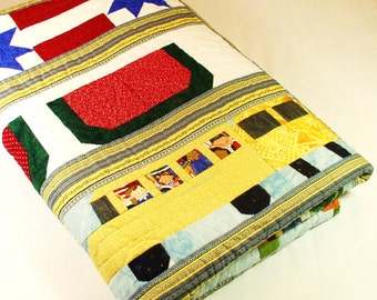 Hand Quilted Queen Sized Quilt with 12 different patterns, sailboat, school bus, pumpkins, snowflake, angels, kites, pinwheels, flags, leaf