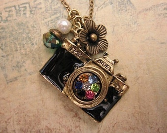 Take a picture. a vintage camera necklace adorned with  pearl and crystal bead