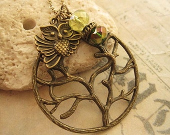 Old Tree. a charm necklace with crystals and owl charm accent