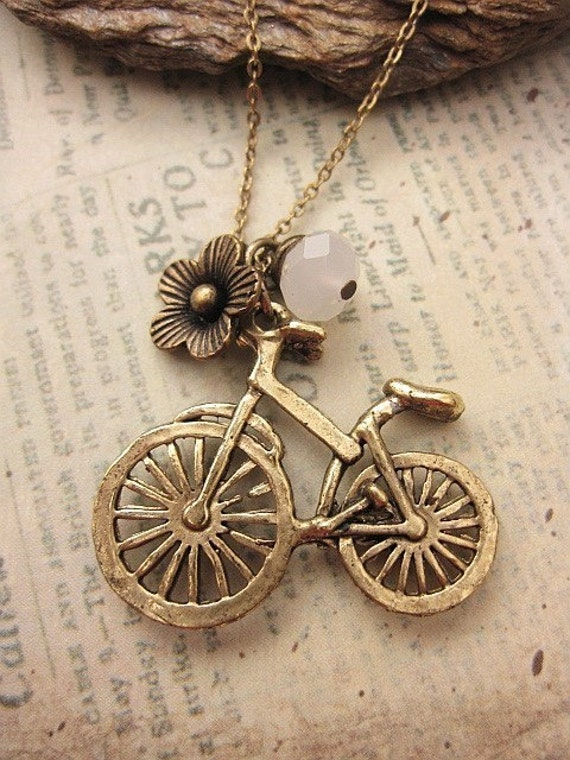 A fine day for biking. a charm necklace