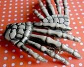 bony hands - skeleton barrettes