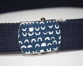 A Little Blue Belt Buckle in White on Blue