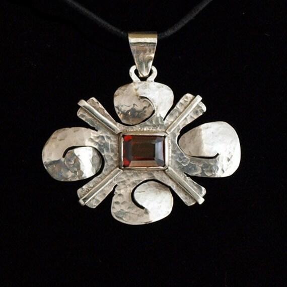 Movement Glyph pendant