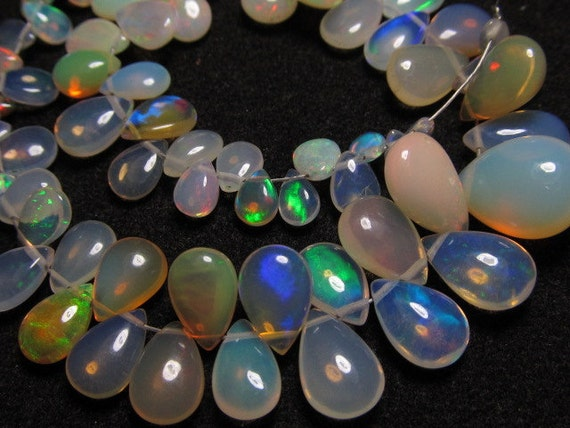 8 inches strand Trully Nice Quality - Ethiopian Opal - Smooth Polished Pear Briolett Full Flashy amazing Fire Huge size 5x4 - 9x12 -  65pcs