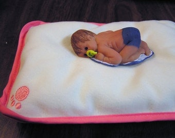 "polymer clay sculpt, baby Clayboy with pacifier , pillow, painted hair, genesis paint, 2.5"" long."