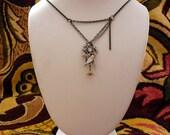 The Caroline (rhinestoned, geared bird necklace)