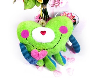 Greeny. a cute green and pink dripping heart character, 'corazon chorreante'. special St Valentine's Day