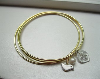 Tweetness.  Bangles with Bird, Leaf and Freshwater Pearl in Gold