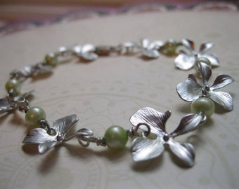 Na Pali.   Silver Orchid and Fresh Water Pearl Bracelet