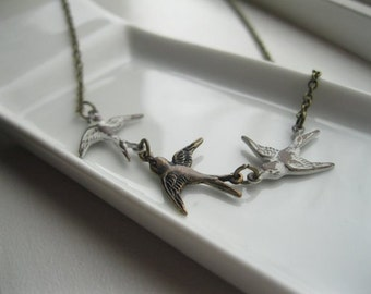 Follow Me.  Bird Necklace with White and Antique Brass Birds.
