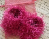 Fluffy bubblegum pink hand knitted snowball booties with matching gift bag