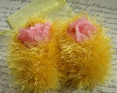 Fluffy sunshine yellow hand knitted snowball booties with matching gift bag