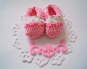 Baby shower cake topper: cute hand knit baby pink booties with Swiss lace trim on pretty felt base