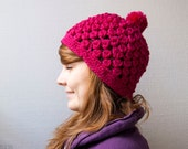 Chunky pom pom hat in dark pink crocheted beanie hat