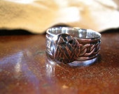 silver with textured copper ring