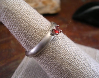 brushed silver band with garnet ring