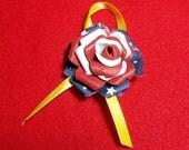 Patriotic rose pin.