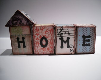 Ephemera houses ...  Wood blocks that spell out home.. vintage paper..old stamps.. funky home decor..awesome from every side