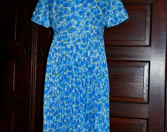 1950s Cotton/Poly Dress with rhinestone button detail and pleated skirt.