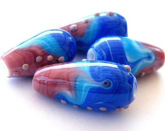 Lampwork glass beads set in blue, purple and turquoise